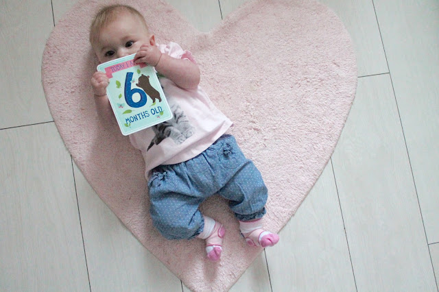 baby chewing six month milestone card