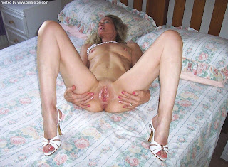 hot mature spreading her legs