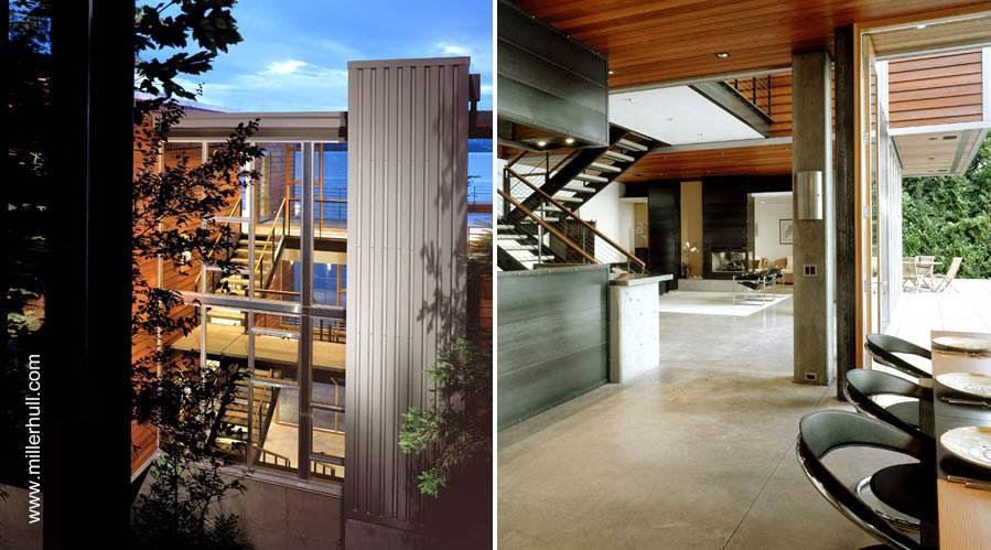 Escalera principal en medio y una vista del interior de la moderna residencia