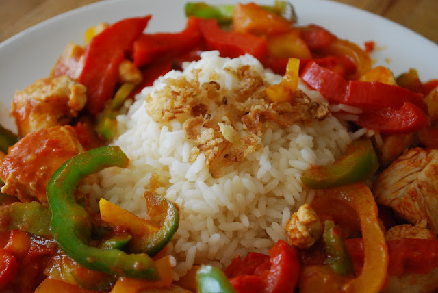 tasty spicy chicken with paprika in 15 minutes with rice and dry onions