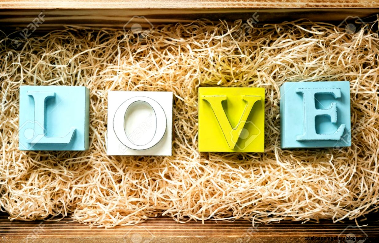 The Word Love Spelled Out In Big Block Letters In A Wooden Gift