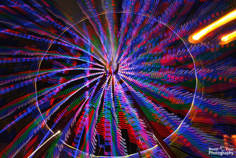 Ferris Wheel Zoom Burst - Capturing Motion in Photography | Boost Your Photography