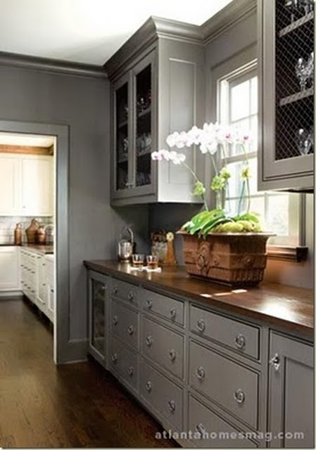 Beautiful combination of wood counters with the grey cabinets