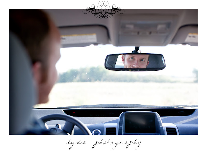 Lifestyle maternity portraits looking in rear view mirror at William Jessup University in Rocklin, California