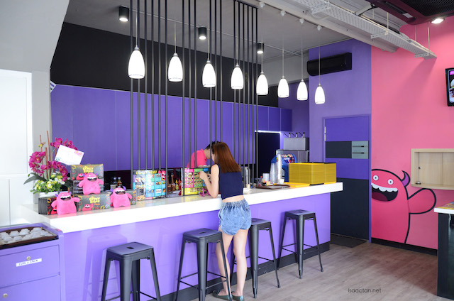 Brightly lit interior, with purple, pink and yellow being the bright colours used