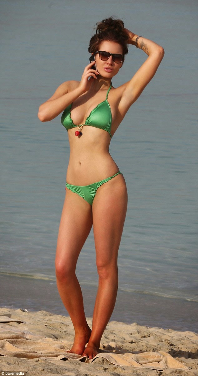 Helen Flanagan green bikini flaunts her figure on beach in Dubai 1