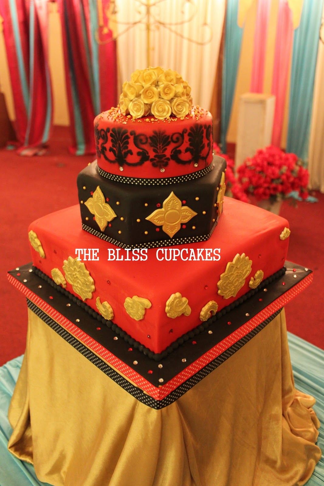 The Bliss Cupcakes Red Black and Gold Wedding Cake