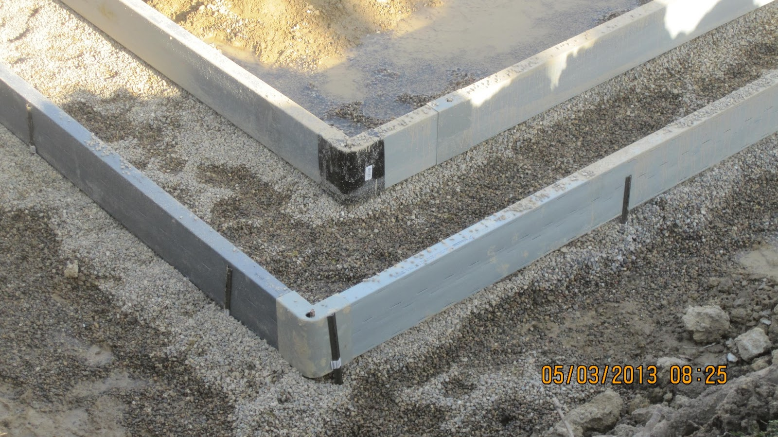 Energy efficient building network footings for insulating for Insulated concrete forms basement