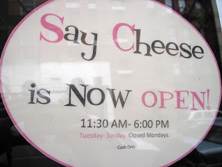 The sign for Say Cheese makes this new in New York restaurant stand out from the street