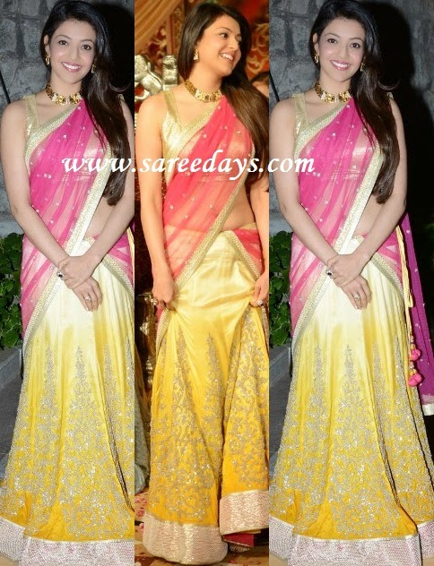 Latest saree designs kajal agarwal in pink and yellow lehenga style checkout kajal agarwal in pink and yellow lehenga style saree with pink netted pallu with work border and yellow crepe lehenga with silver appliqued border altavistaventures Image collections