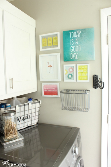 Gallery wall in an organized laundry room