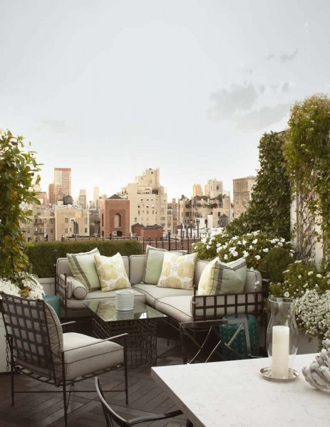 City balcony turned into a living room with a sectional sofa with a wire frame and matching arm chair and coffee table
