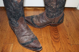 picture of muddy cowboy boots