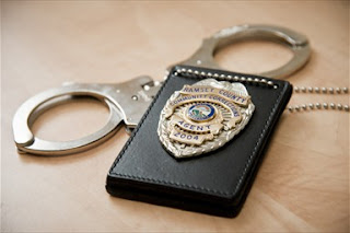 Officers badge and cuffs