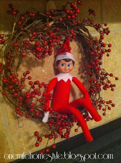 Elf on the Shelf hanging out on the wreath