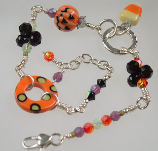 Pumpkin and Candy Corn Halloween bracelet with crystals and porcelain handmade beads.