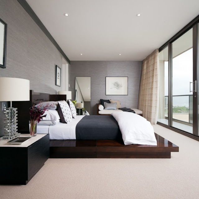 Photo of an amazing modern bedroom with king sized wooden bed