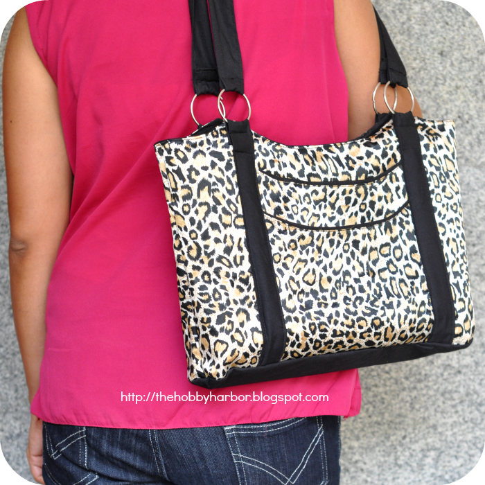 Handbag sewing pattern pdf printable nag made with satin fabric with leopord print and black contrast with rings