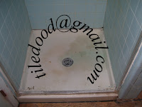 This photo shows a typical old cracked acrylic shower base.