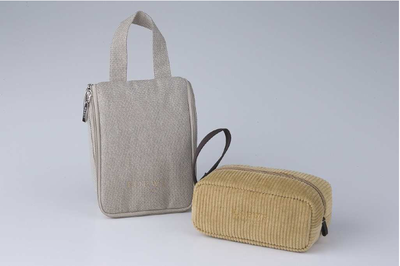 Spring/summer version of JAL First Class amenity kits for outbound (left) and inbound (right) flights