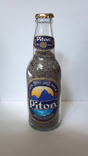 beach sand in a piton beer bottle from anse chastanet resort in st. lucia