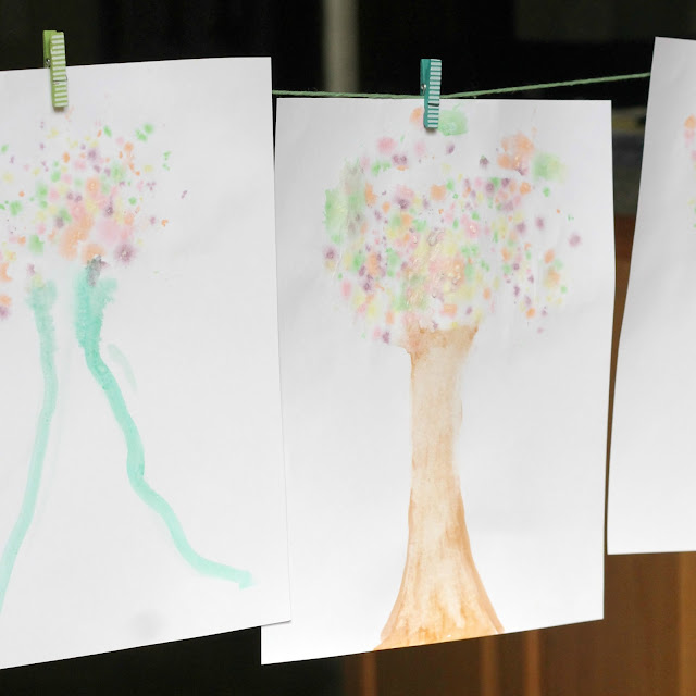 Instead of eating all that Halloween candy, kids can use it to make colorful fall trees.