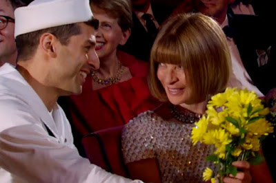 Tony Yazbeck (TONY Award Nominee for Leading Actor in a Musical) presents flowers to Anna Wintour of American Vogue
