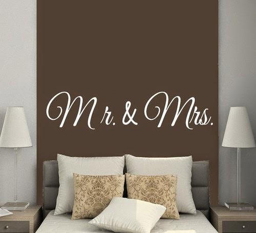 vinilo sobre cama de matrimonio