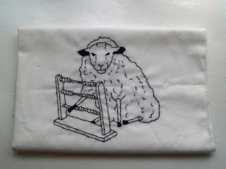Broderi af får. Humor.