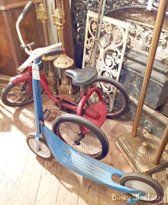 Vintage metal red tricycle and light blue scooter on BinkysNest.com