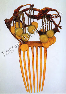 A cherries haircomb of horn, enamel gold and diamonds. Some of the cherries are of carved stained horn, others overlaid with enamel, their stems set with diamonds. Shown at the Paris Salon in 1903.