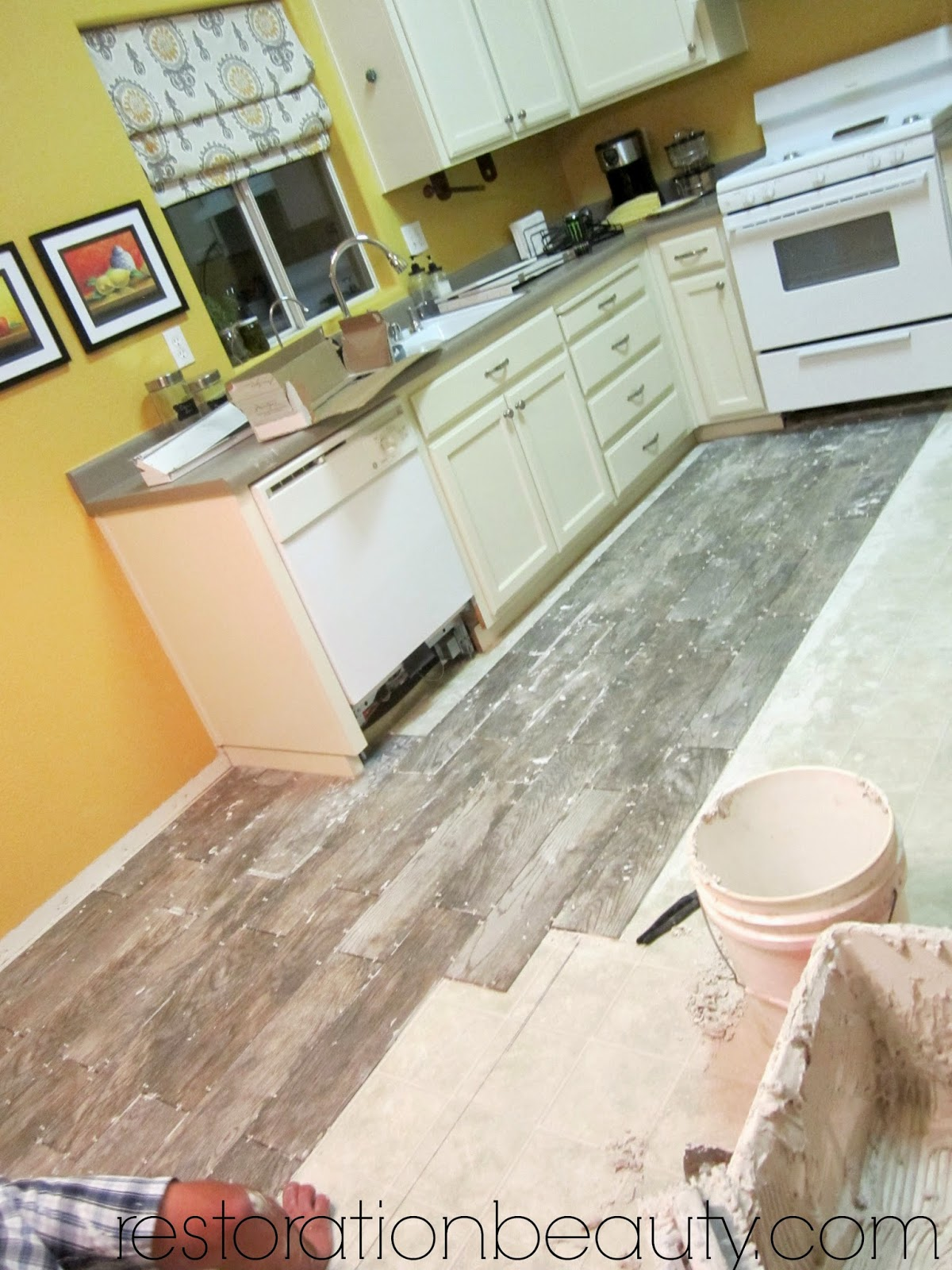 Restoration beauty faux wood tile flooring in the kitchen we went with faux wood tile since its more durable and budget friendly and honestly you cant even tell that its tile since the grout color blends in dailygadgetfo Choice Image