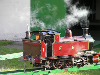 red miniature steam train broken down, narrowguage serial 1FR