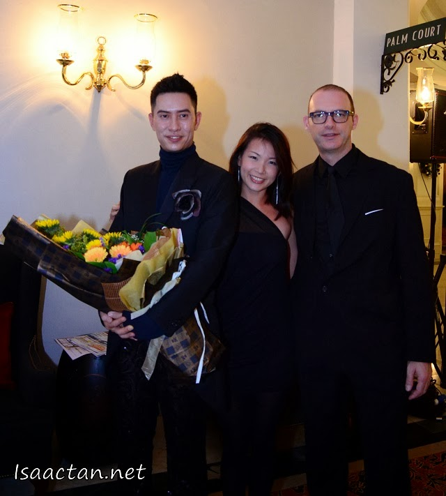 Brandon Tan, creative director of Bran et Daguet posing with guests of the 'Secret Rendezvous' Fashion Show