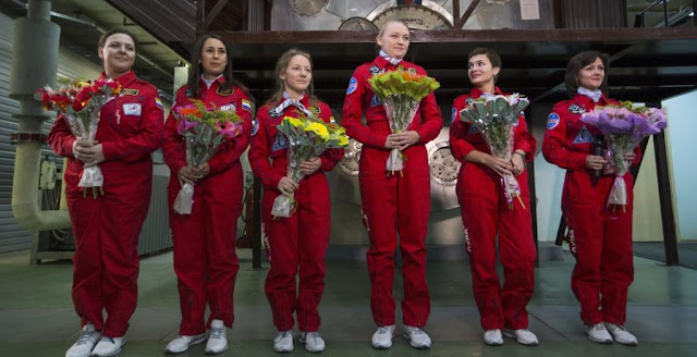 From left, Daria Komissarova, Tatyana Shuguyeva, Polina Kuznetsova, Inna Nosikova, Anna Kussmaul and Elena Luchitskaya answer questions after the eight-day imitation flight to the moon at a mock-up spaceship, in Moscow, Russia, Nov. 6, 2015. Credit: AP