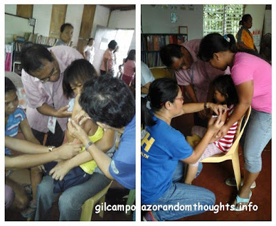 Kids immunized held by their parents