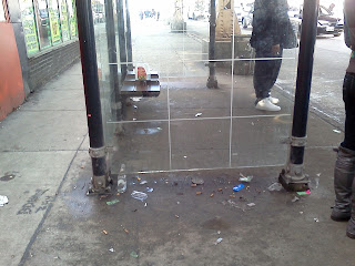 Poverty represented by litter at a bus stop in a Chicago hood