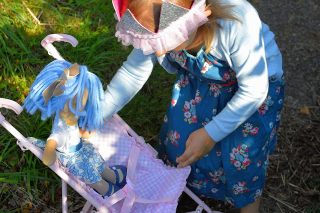 Roleplay doll and pram