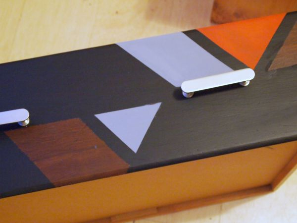 Use tape to create geometric patterns on furniture, it's super easy!