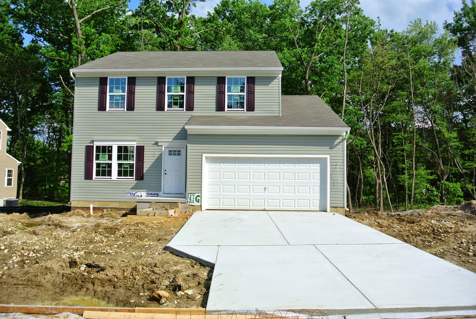 Picture of the Ryan Home Florence Model being constructed with driveway installed