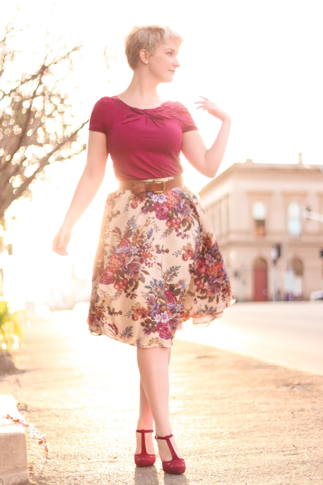 Liana of Finding Femme wears wine coloured shirt, Modcloth ikebana tapestry floral midi skirt, Modcloth suede berry coloured heels.
