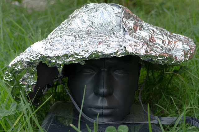 alfoil over sun hat on top of plastic head