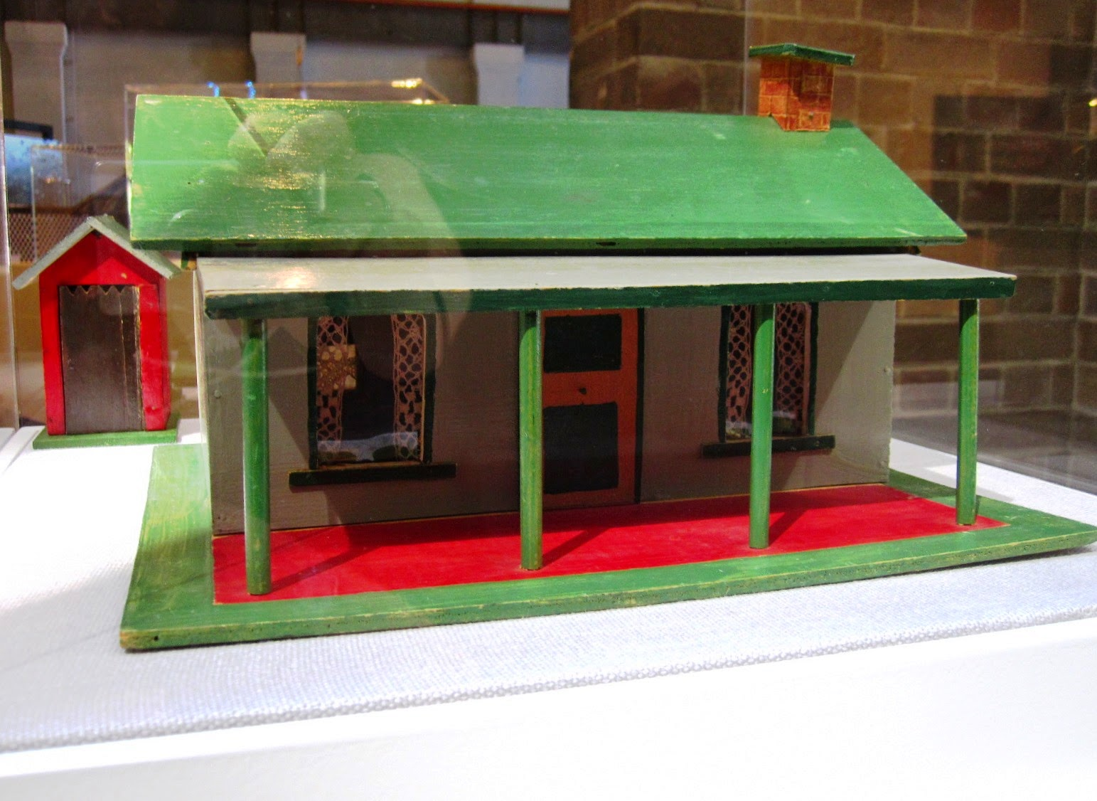 Front view of a vintage toy farm outhouse and house from Sydney shop Walther & Stevenson.