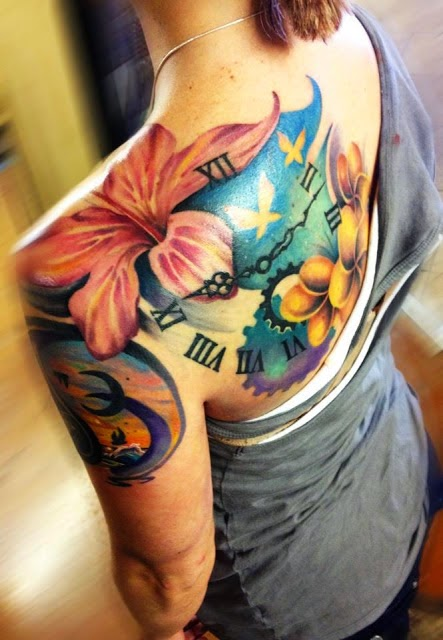 Clock and lilly tattoo on back