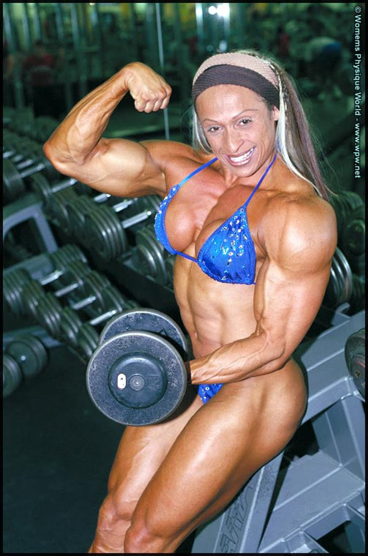 Betty Viana - Adkins Flexing Her Biceps In A Blue Bikini