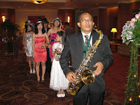 The saxophonist getting ready to usher in the wedding couple during their entrance