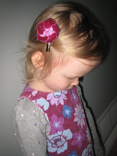 Artemis Wearing Baby Clay Flower Barrette
