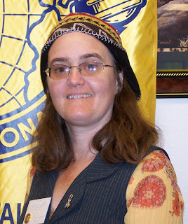Cynthia Parkhill with Toastmasters member badge