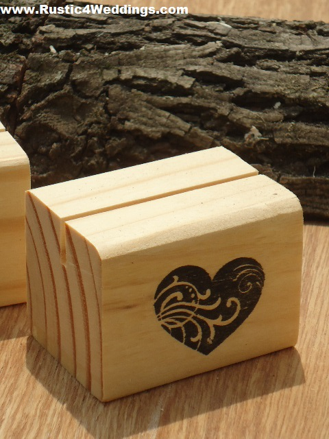 heart stamped wood place card holders or table number holders for rustic weddings or other events