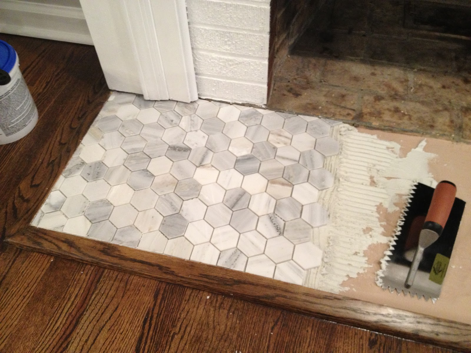 retro ranch reno operation hearth re tile let the laying begin